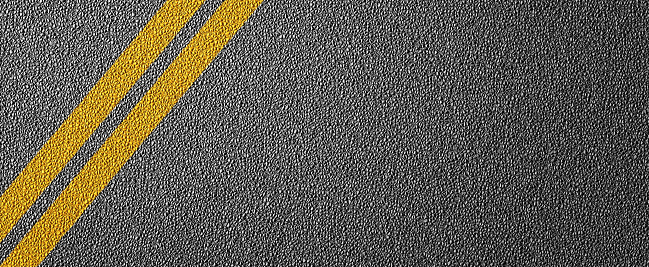 621693226 istock photo 3D Illustration of a road divide with yellow lines pattern and background, textured traffic rules concept. 1225798369