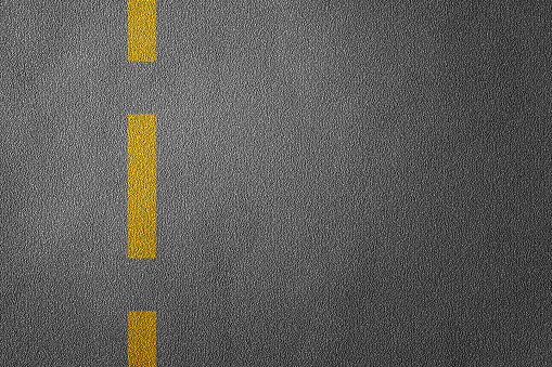 621693226 istock photo 3D Illustration of a road divide with yellow lines pattern and background, textured traffic rules concept. 1225800208