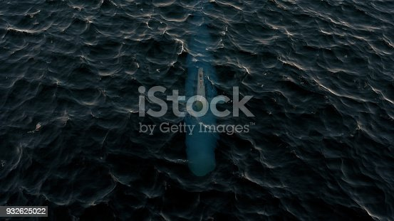 istock 3D Illustration of a submarine patrolling just below the water's surface 932625022