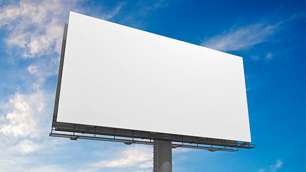 3D illustration of blank white billboard against blue sky. stock photo