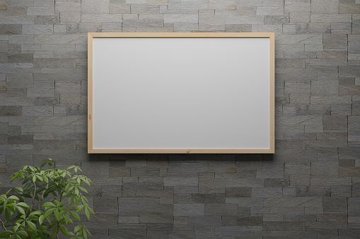 3D illustration of blank whiteboard on the brick wall