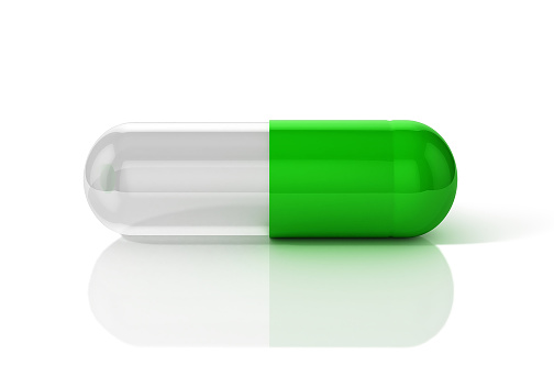 istock 3D Illustration of capsule pill in green and transparent combination 1202684096
