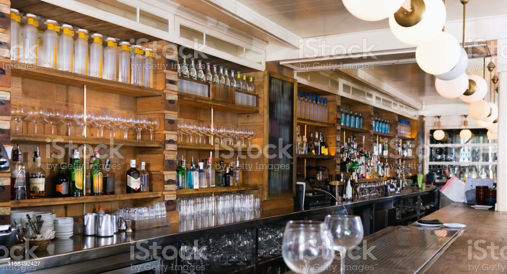 Illustration of empty fashionable modern stylish bar with alcohol in...