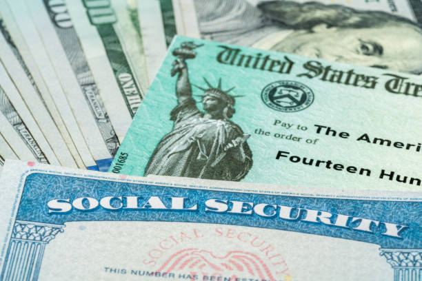 Illustration of the 2021 federal stimulus check from the IRS with cash and social security card stock photo