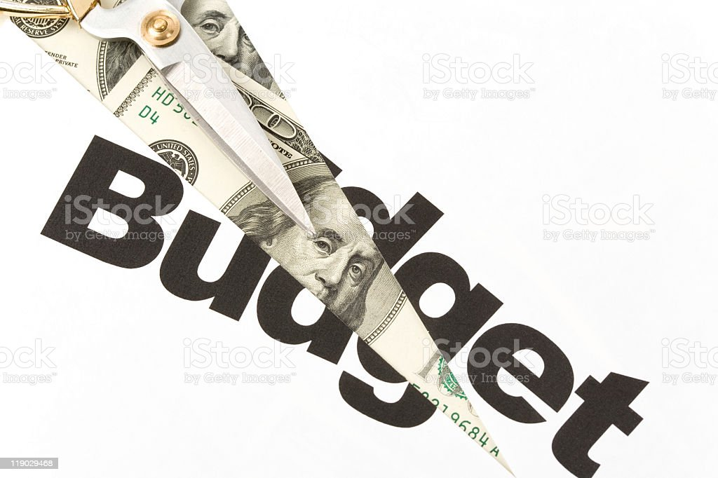 Illustration of the word budget cut by dollar paper plane royalty-free stock photo