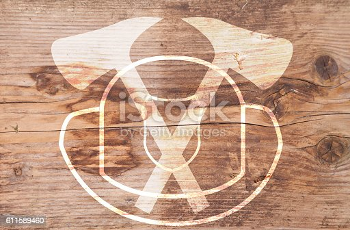 istock Illustration of white helmet and axes on brown wooden background 611589460