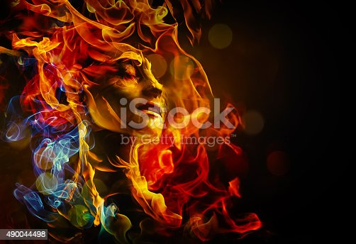 istock Illustration of woman's face made with fire 490044498