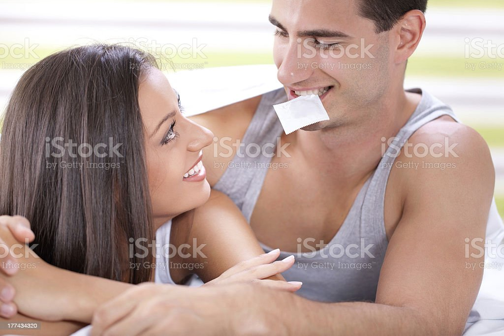 Illustration safe sex with guy holding a condom in his mouth stock photo