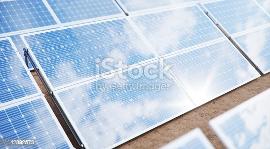 istock 3D illustration Solar Panels. Alternative energy. Concept of renewable energy. Ecological, clean energy. Solar panels, photovoltaic with reflection beautiful blue sky. Solar panels in the desert 1142892573