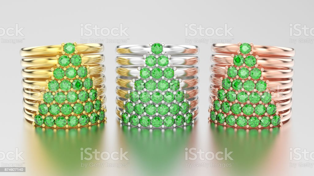 3D illustration three different gold decorative diamond rings with green emerald diamonds in the form of a сhristmas tree stock photo