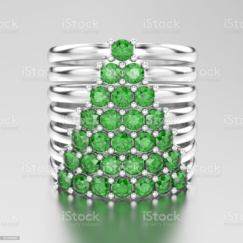 3D illustration white gold or silver decorative diamond rings with green emerald diamonds in the form of a сhristmas tree stock photo