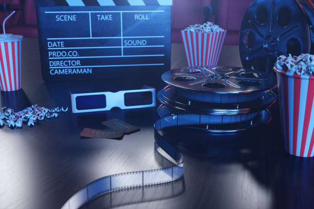 3D illustration with popcorn, cinema reel, clapperboard and two tickets with blue light. Concept cinema hall and theater. Red chairs in the cinema hall in the background. stock photo