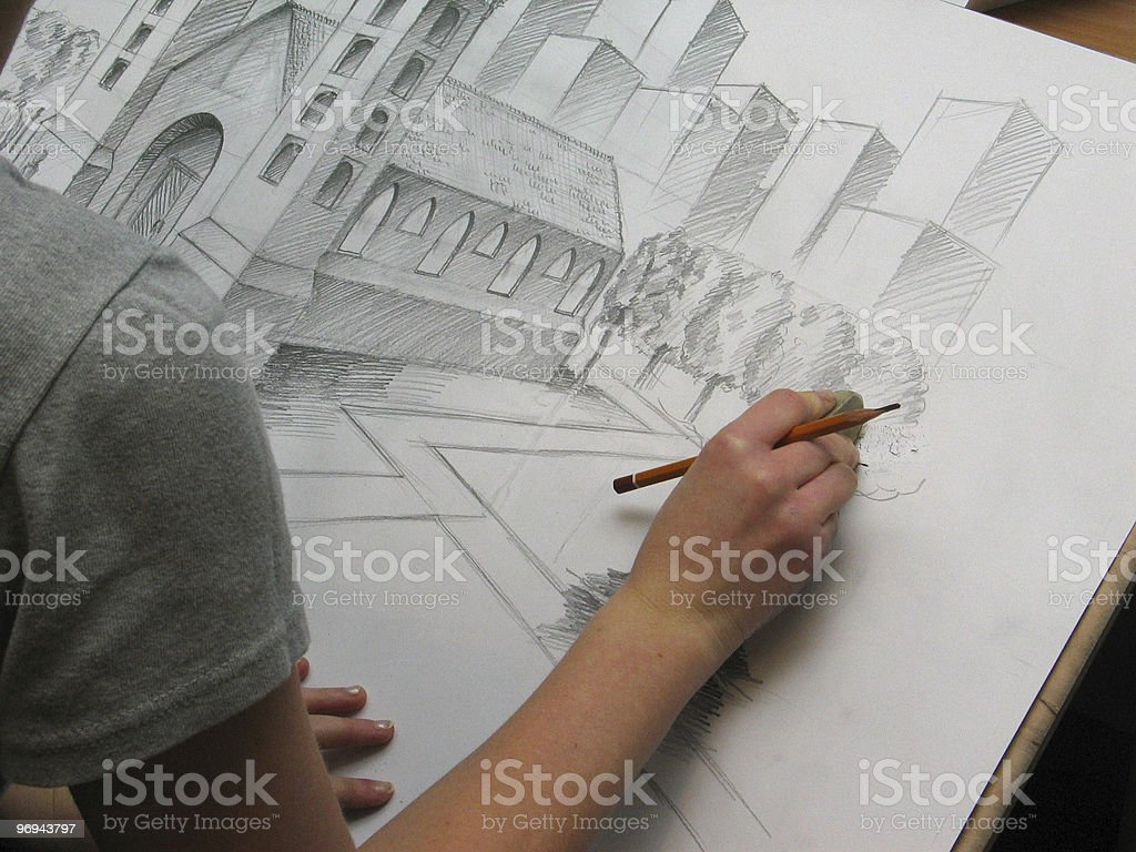 illustrator at work drawing a church royalty-free stock photo