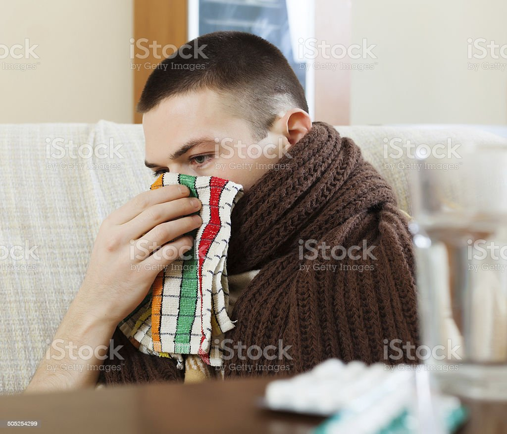 Ilness man in scarf using handkerchief stock photo