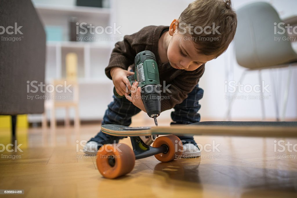 Im fixnig this longboard stock photo