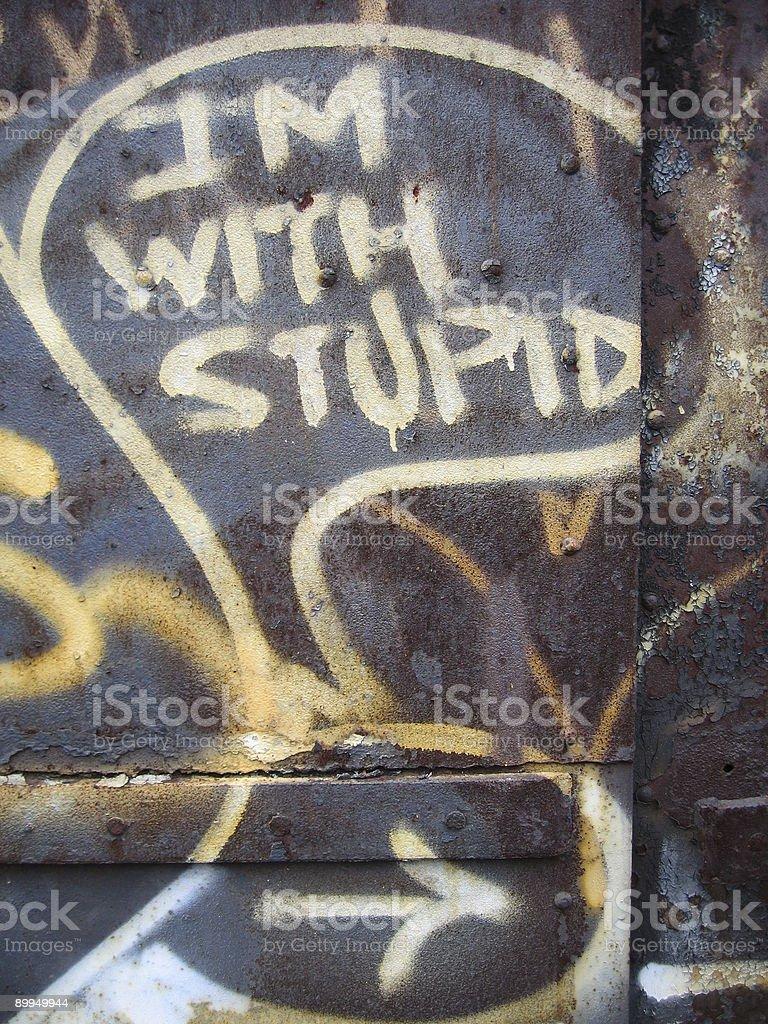 i'm with stupid graffiti stock photo