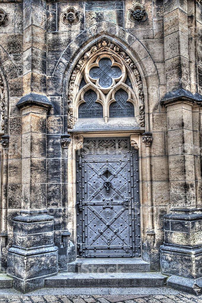 HDR Image ancient metal door and walls of church stock photo