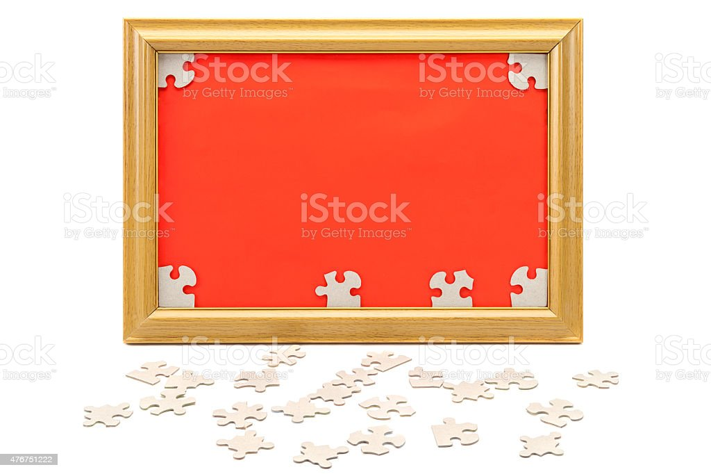 Image in the frame and scattered puzzle. stock photo
