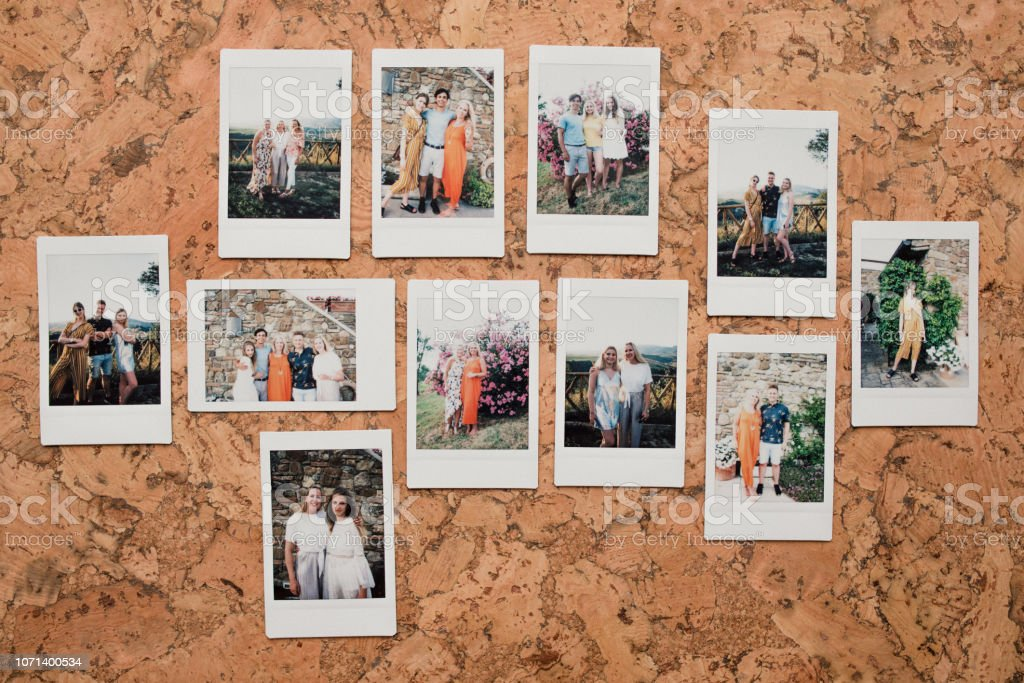 Knolling flat lay shot of instant film photos of friends on holiday...