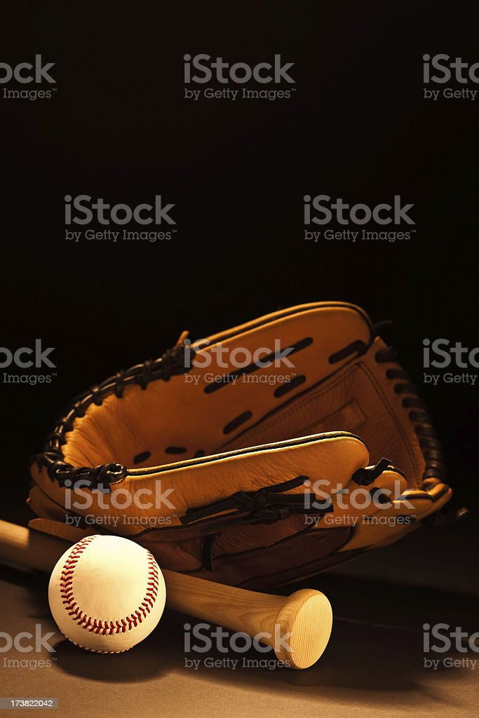 Image of a baseball glove with bat and ball stock photo