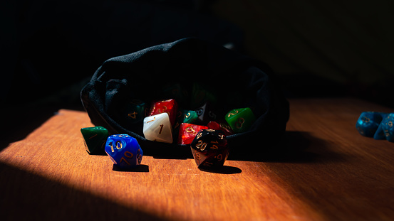 Image of a black and red marbled 20-sided rpg die