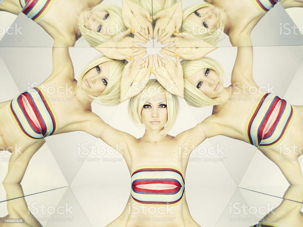 Image of a blonde woman in a bikini in a kaleidoscope stock photo
