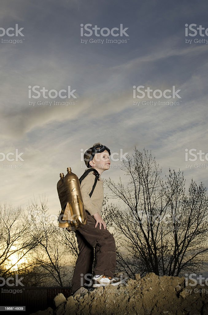 Image of a child wearing jet pack climbing royalty-free stock photo