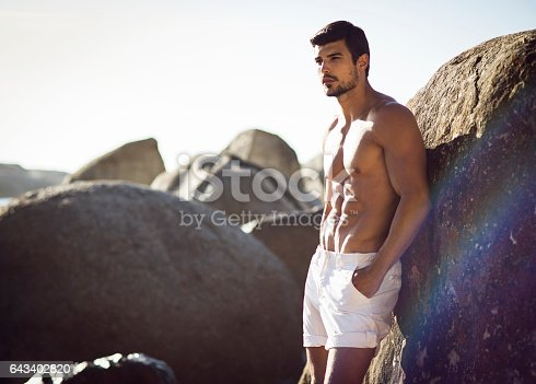 519676858 istock photo image of a handsome fit man at sea 643402820