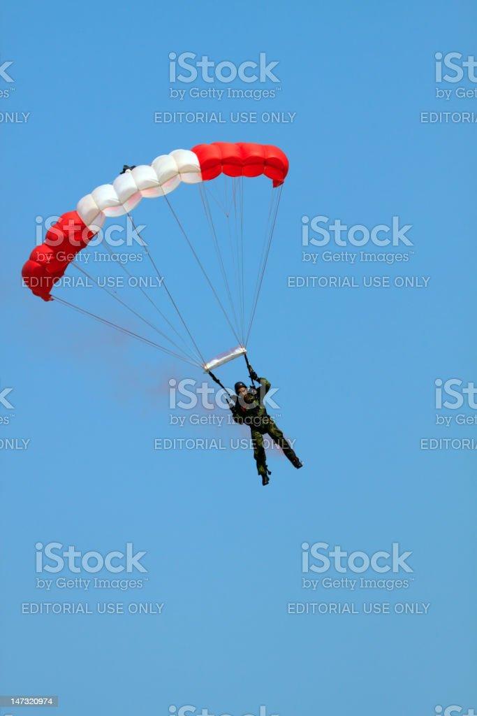 DSLR image of a man parachuting at airshow royalty-free stock photo