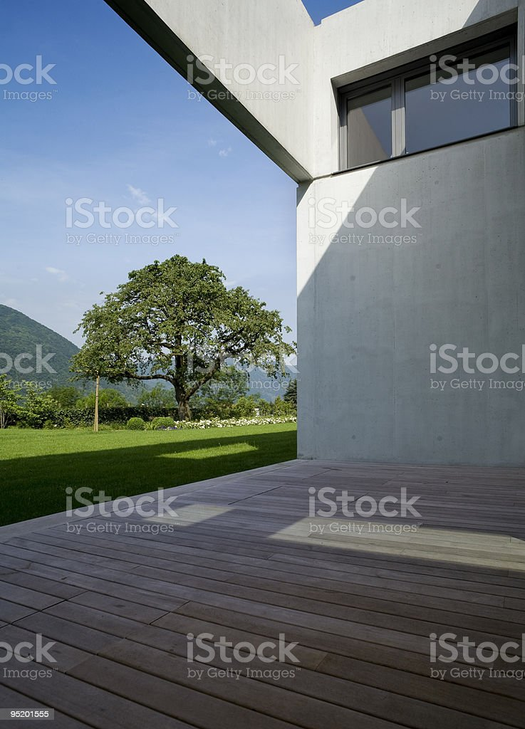 Image of a modern house taken from the wooden patio royalty-free stock photo