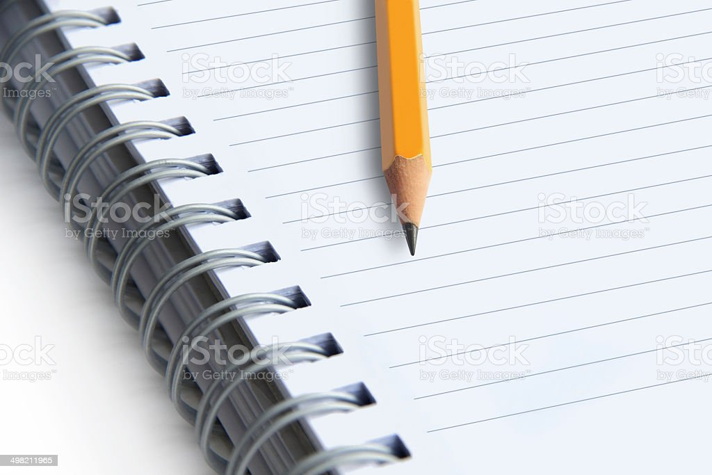 image of a notebooks and pencil on white background, close-up stock photo