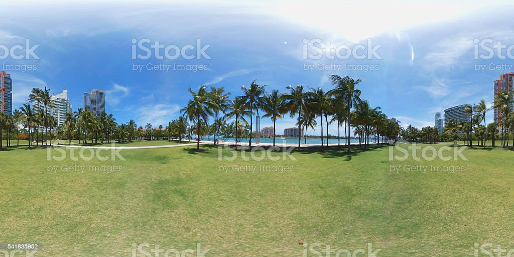 360 image of a park with palm trees stock photo