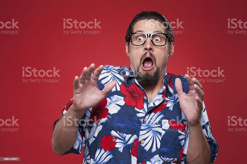Image of a scared young man in Hawaiian shirt royalty-free stock photo