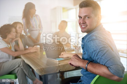 istock Image of a succesful casual business man using laptop during 531267270