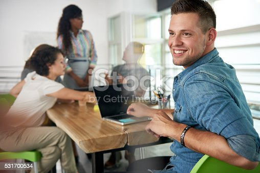 istock Image of a succesful casual business man using laptop during 531700534