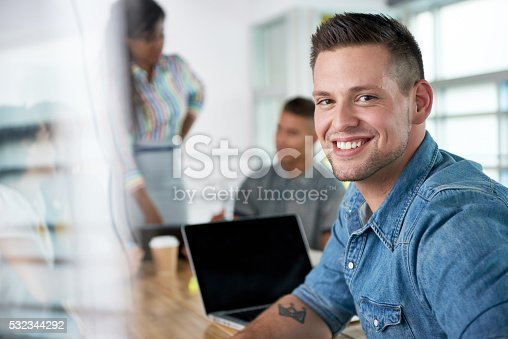 istock Image of a succesful casual business man using laptop during 532344292