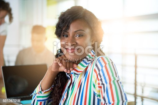 istock Image of a succesful casual business woman using laptop during 531267018