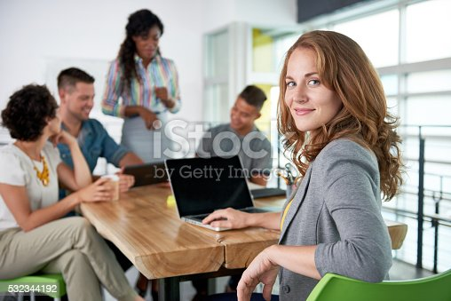 istock Image of a succesful casual business woman using laptop during 532344192