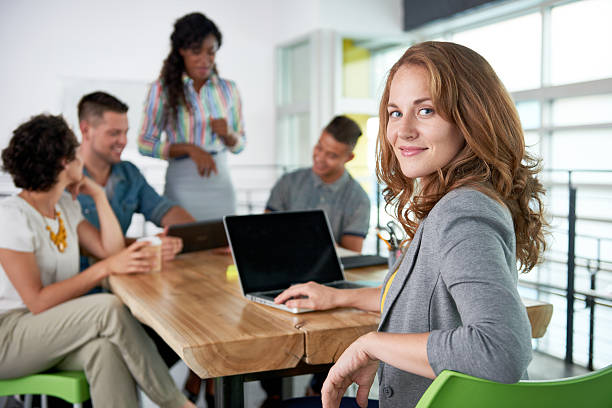 Image of a succesful casual business woman using laptop during picture id532344192?b=1&k=6&m=532344192&s=612x612&w=0&h=ncyhbb k4knrkfidunfczxmahhhjwqfqh8hlcxwtxjo=