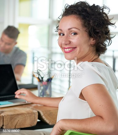 istock Image of a succesful casual business woman using laptop during 537618802