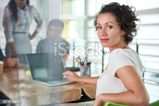 istock Image of a succesful casual business woman using laptop during 537618872