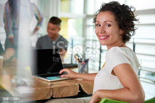 istock Image of a succesful casual business woman using laptop during 539122684
