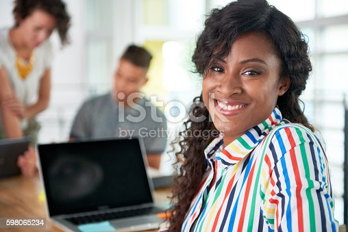 istock Image of a succesful casual business woman using laptop during 598065234