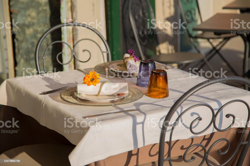 Image Of A Table For Two Of Restaurant In Preparation For Dinner With Cutlery And Glasses Stock Photo Download Image Now Istock