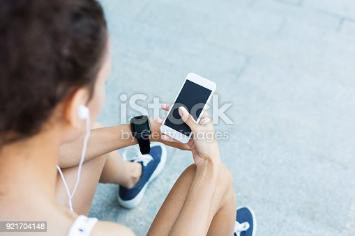 istock Image of a woman using smartphone with blank screen outdoors 921704148