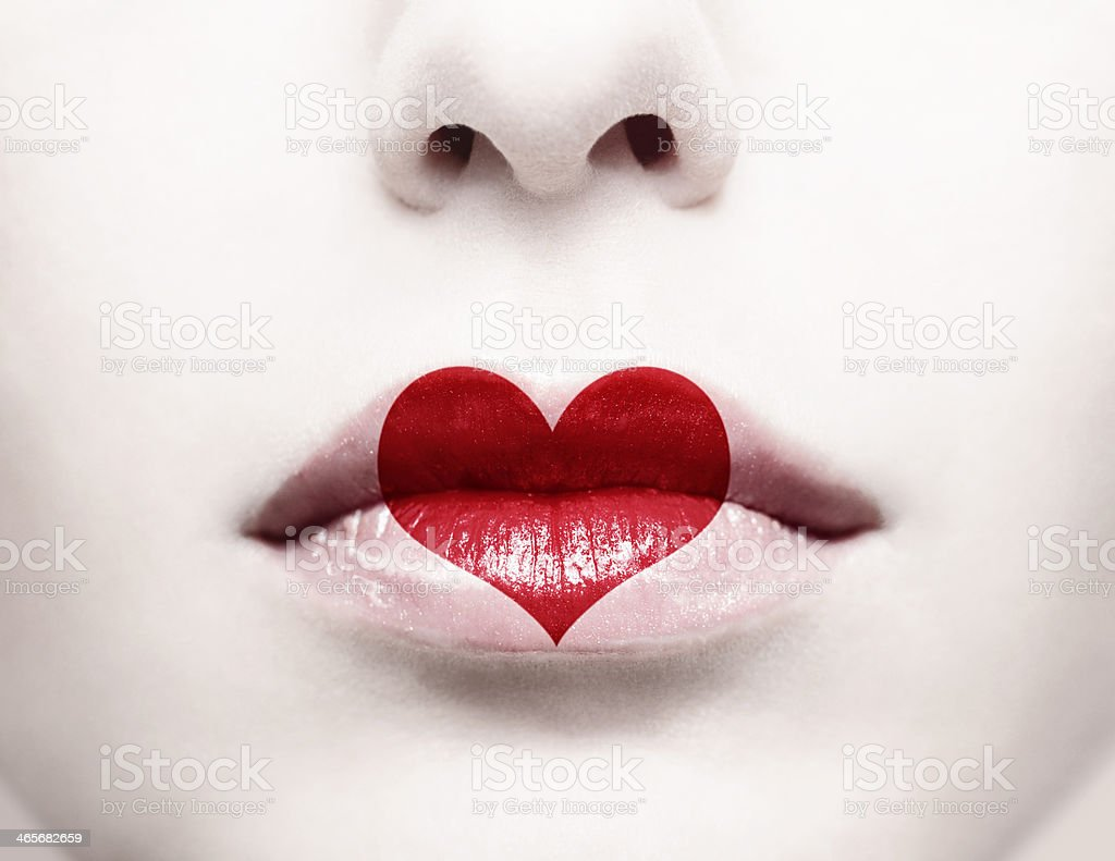 Image of a woman's nose and lips with a heart icon on mouth stock photo