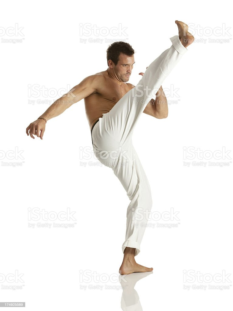 Image of a young man practicing capoeira royalty-free stock photo