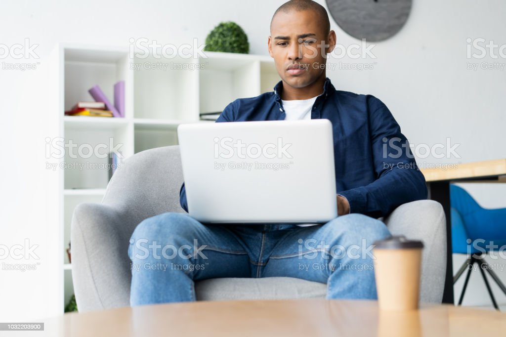 Image Of African American Businessman Working On His Laptop Handsome Young Man At His Desk Stock Photo Download Image Now