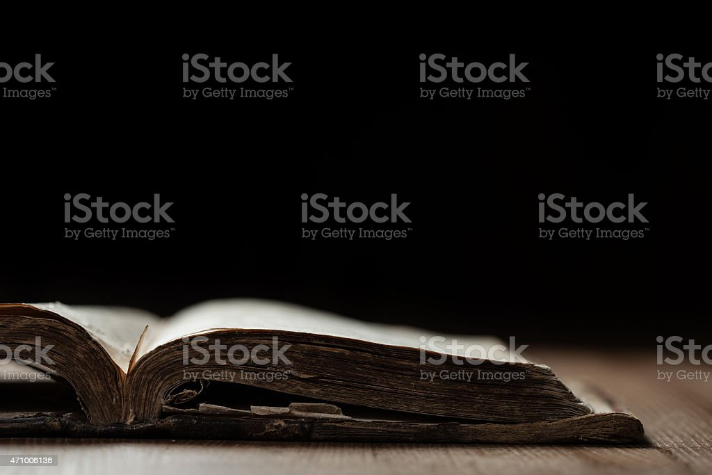 Image of an old Holy Bible on wooden background stock photo