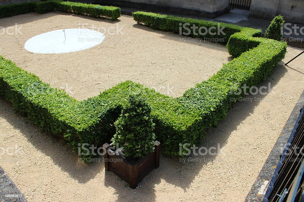 Photo showing an ornate knot garden with clipped buxus hedging , and...